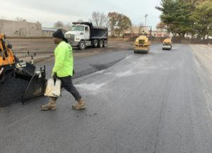 rolling an asphalt parking lot
