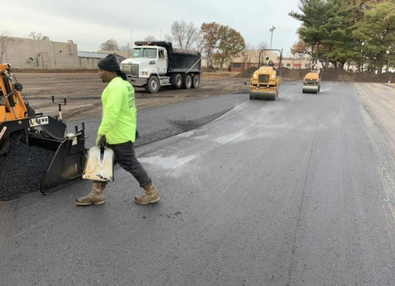 rolling an asphalt parking lot