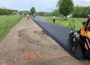 laying an asphalt driveway